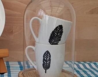 hand-drawn mug with feather illustration