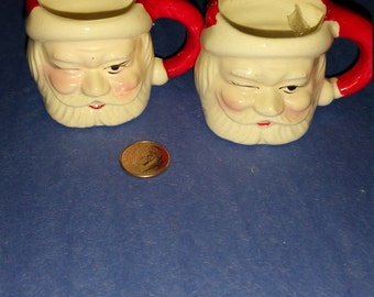 Vintage 1963 mini santa winking (2) candle holders or mugs