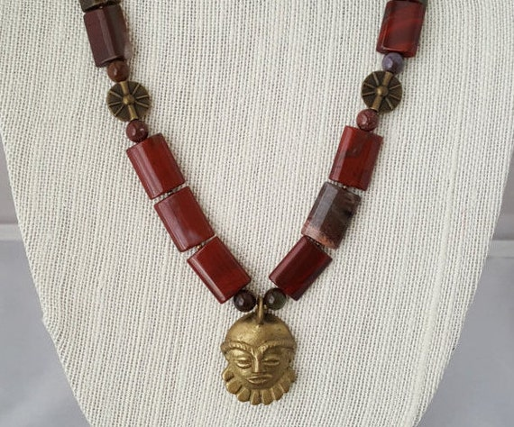 Red jasper and brass necklace with mask pendant