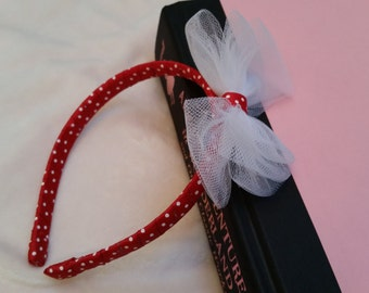 Minnie inspired headband with soft white tulle and cute red/white polkadot. Fits toddlers and most kids.
