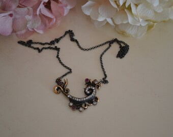 Oxidized Sterling Silver necklace with ruby and cubic zirconia  stones.