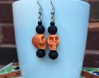 Orange skull and lava stone earrings