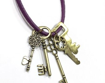 Skeleton Key Necklace. Keys on a necklace. 5 brass key charms on a suede cord of your color choice and length.