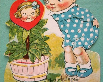 Vintage Valentine's Day Card Boy Kissing Girl in Flower