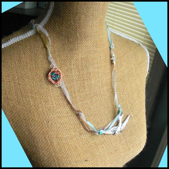 Silver Swallow & Copper Bird's Nest Necklace. One Of A Kind, bronze copper silver bead, cable chain, sheer white/blue ribbon, brass filigree