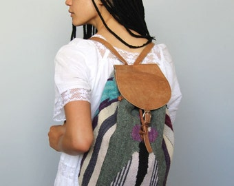 the graduate -- vintage 80s woven leather detail backpack