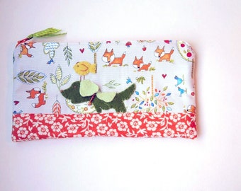 "Zipper Pouch, 5x9"" in green, orange, yellow, blue, gray and coral woodland fabric with Handmade Felt Dog Embellishment, Dog Zipper Pouch"