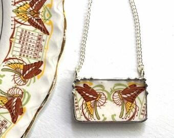 Broken china jewelry necklace. Boho Chic broken china jewelry antique 1915 calendar plate Art Nouveau butterflies luna