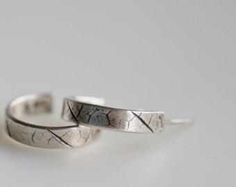 Sterling silver hoop earrings with leaf texture, half round hoops, hoop posts, hoop stud earrings. Sterling silver and fine silver.