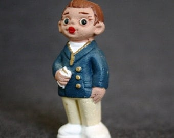 Vintage Spanish terracotta little boy figurine.