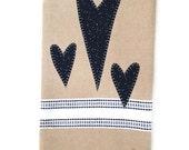Linen colored dish towel  three dark blue appliqué hearts