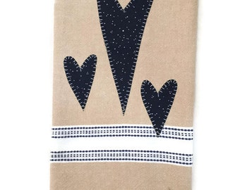 Linen colored dish towel  three dark blue appliqué hearts