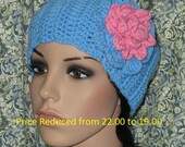 Ear warmer crocheted. with a large pink  rose on top.  PRICE REDUCED   FROM  22.00 -19.00