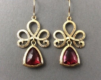 Gold Crystal Earrings With Darch Fuchsia Faceted Glass Pendant