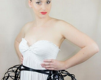 Two pieces worn together double pannier black ribbon and lacing Crinoline long cage hoop bustle