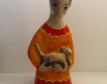 Vintage Paper Mache Sculpture. Modernist female figure holding a cat.  Signed Serrano Mexico.