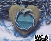 Dolphin and Seascape ornament -  hand-painted wooden heart. All proceeds to the World Cetacean Alliance