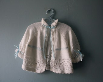 Vintage handknit white baby sweater /  baby cardigan sweater with blue satin ribbon and pointelle details / baby newborn to 12 months