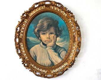 A vintage Framed print of a Crying Boy, 1960s