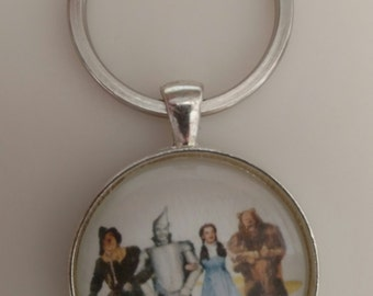 Wizard of Oz-Tinman-Dorothy-Cowardly Lion-Scarecrow-Toto-Oz Pendant-Necklace-Keychain-30mm Glass Dome-Shiny Silver-Round Tray-Purse Charm