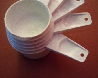 Vintage Tupperware set of white speckled measuring cups baking