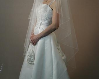 "Wedding veil, Angel cut veil, 58"" length with pencil edging. Made in USA"