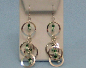Four-Ring Dangle Earrings with Green and White Beads.