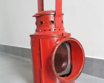 Old railway signal lamp, lamp. Old vintage industrial railroad lantern. Vieille signalisation chemin de fer