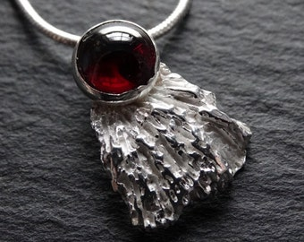 Sterling silver cast coral chip set with garnet cabochon