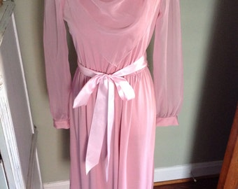 Pink chiffon dress with drapey front.......long sheer sleeves......dressy and elegant.....perfect conditin
