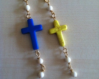 Cross earrings and bone beads.