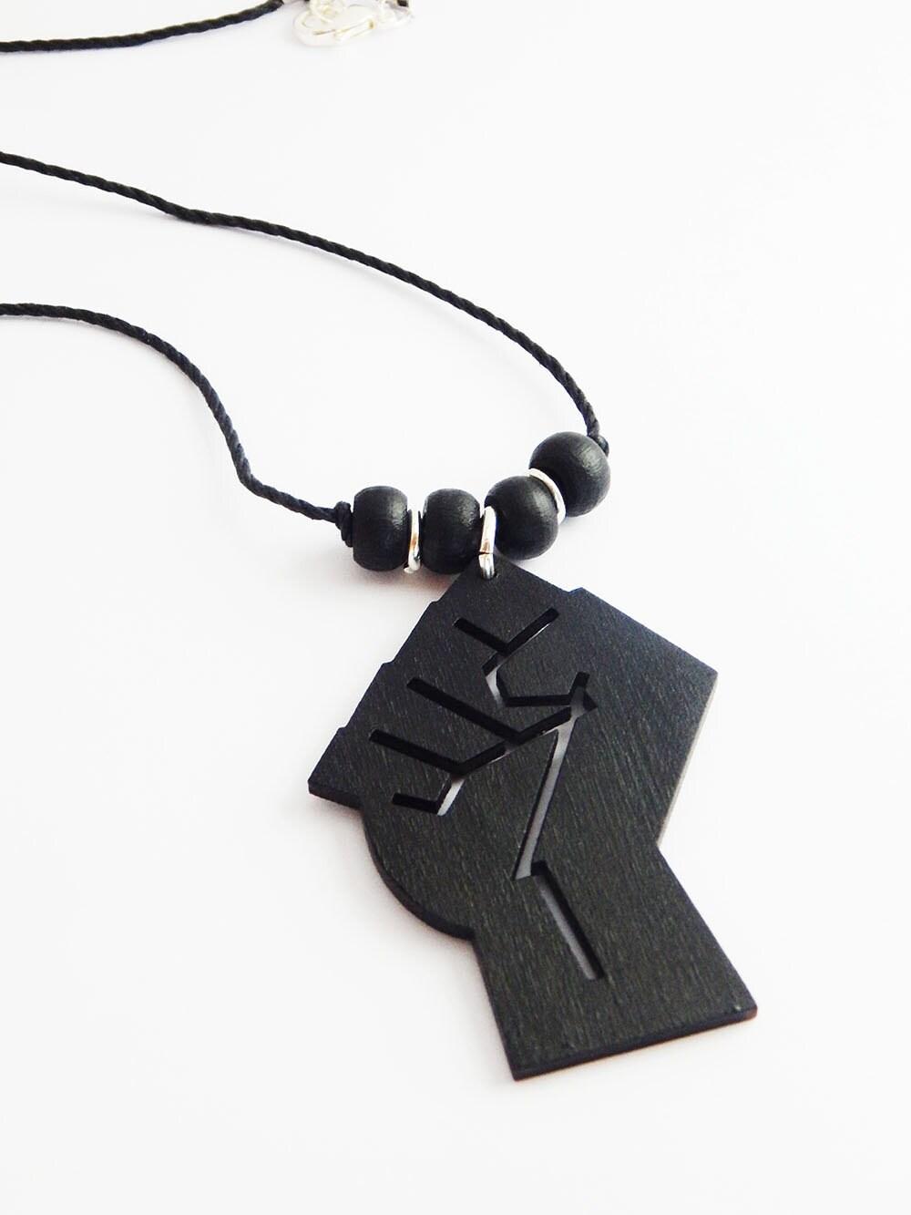Black fist necklace