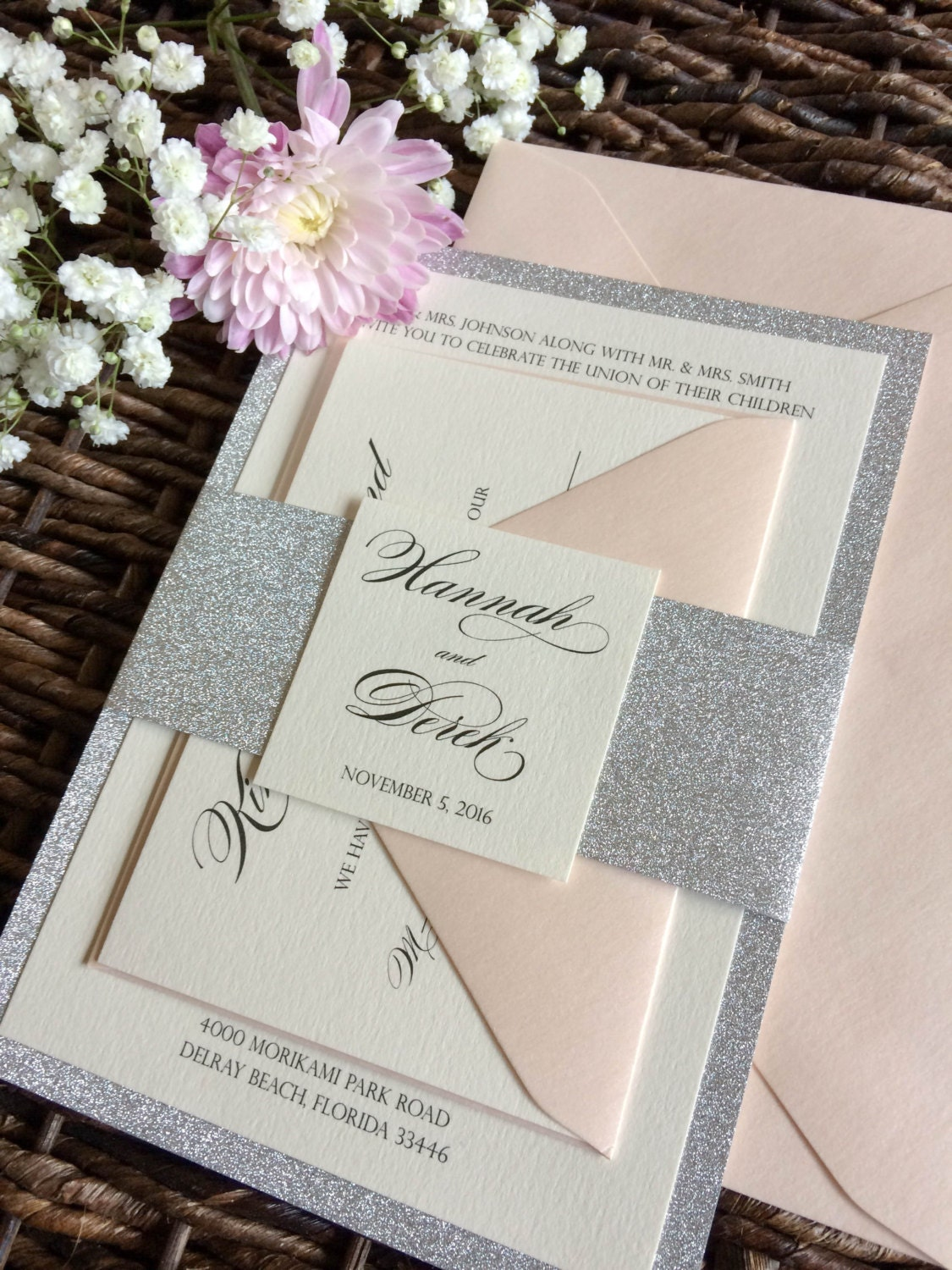 silver glitter wedding invitation with glitter belly band