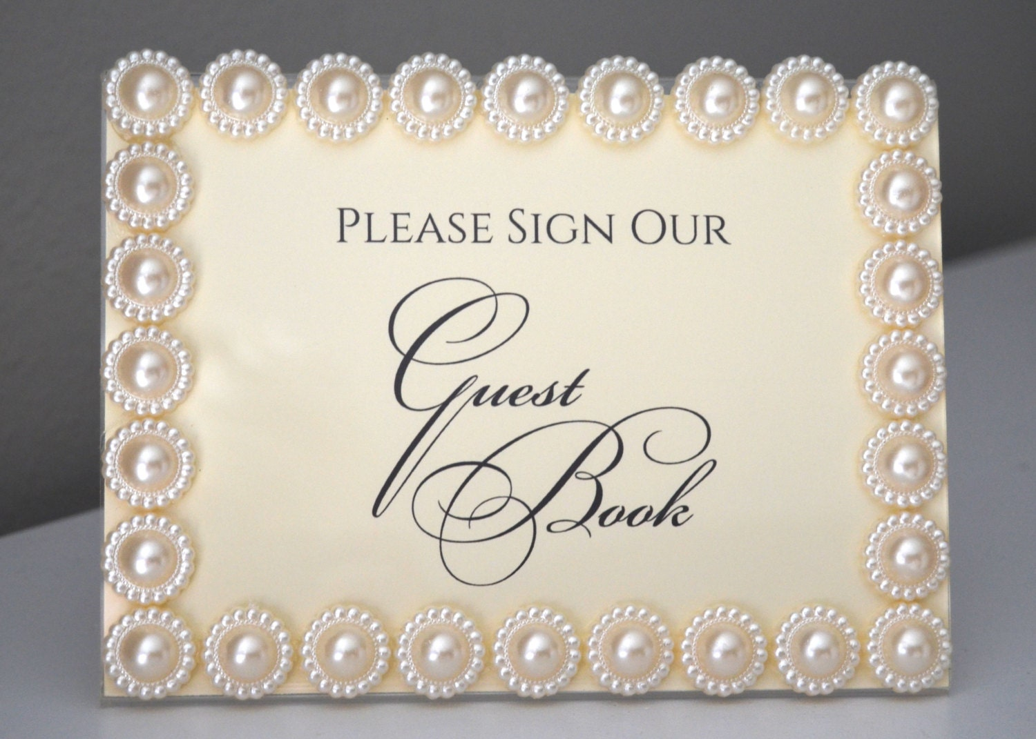 ivory pearl wedding frame with please sign our guest book or