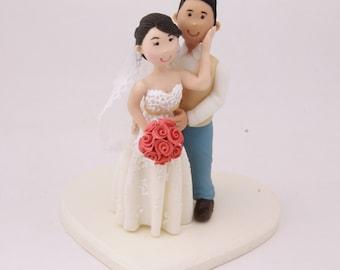 Groom with arms around bride. Custom wedding cake topper. Wedding figurine. Handmade. Fully customizable. Unique keepsake