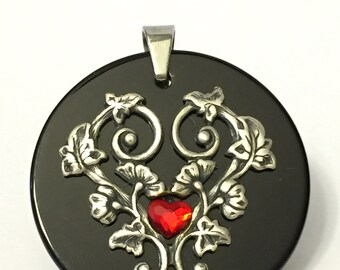 Filigree heart with black onyx and red crystal heart pendant necklace