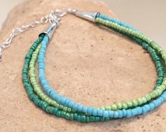 Blue and green triple strand seed bead bracelet, heart charm, charm bracelet, sundance style bracelet, seed bead bracelet, gift for her