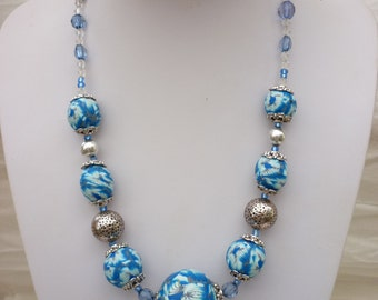 Necklace with  blue polymer beads  with delicate silver lines