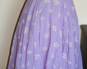 1950s lilac handmade strapless frock with fabulous tulle underskirt and pretty flocked white flower motif. White lace trimmed bodice.Size 10