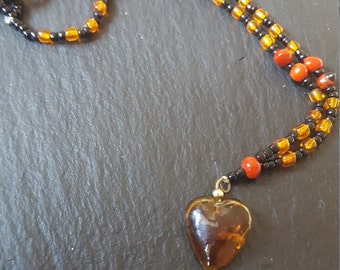 Handmade Shipibo Necklace with seed beads and a coloured heart shaped glass pendant - Variations available