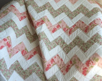 """Florals of Peach, Soft Green and Red Meld Beautifully In This 40.5"""" X 52"""" Zig Zag/Chevron Quilt"""