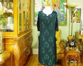 1920's Vintage Beaded Flapper Dress . Rare Apron Side Tie Overdress . Black Silk Crepe . Art Nouveau Sea Green Beads design . Miss Fisher.