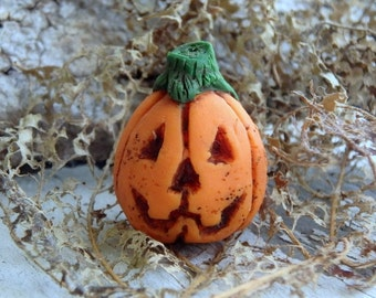 Jack-O-Lantern- polymer clay pumpkin. rustic jack-o-lantern bead. burnt orange bead. rustic fall halloween jewelry pendant. Jettabugjewelry