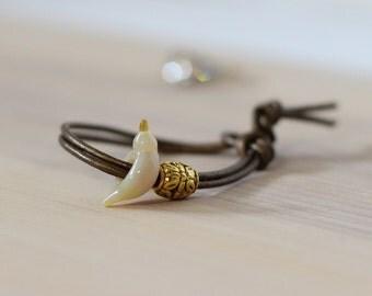 Ivory bird bracelet, bird bead charm with adjustable leather strap, bird jewelry