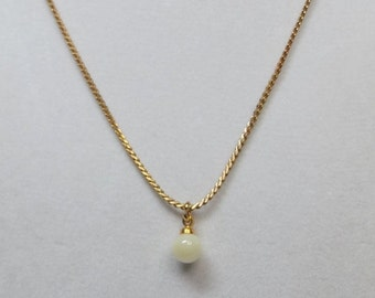 Creamy Mother of Pearl on Gold tone chain