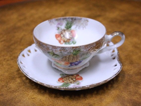 Vintage Delicate Tea Cup And Semi Heart Shaped By