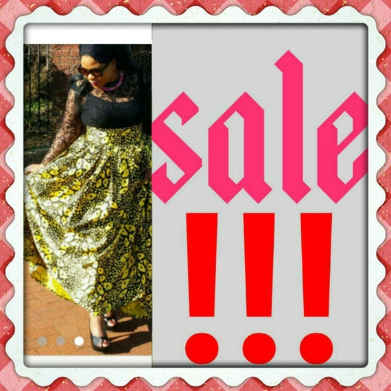 A Curvyswan amazingly printed black and  yellow high waist  maxi skirt with pockets