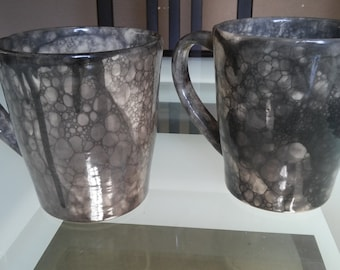Set of two hand thrown mugs with bubble design in black bubble design.