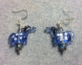 Translucent light blue with white spots lampwork horse bead earrings adorned with light blue Czech glass beads.