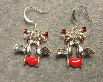 Silver and red enamel dove charm earrings adorned with tiny dangling red and clear Chinese crystal beads.
